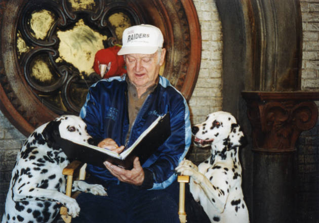 Micky Moore Discussing The Next Scene With Pongo And Perdy While Filming 102 Dalmatians 2000 Micky Moore Collection Pepperdine Digital Collections
